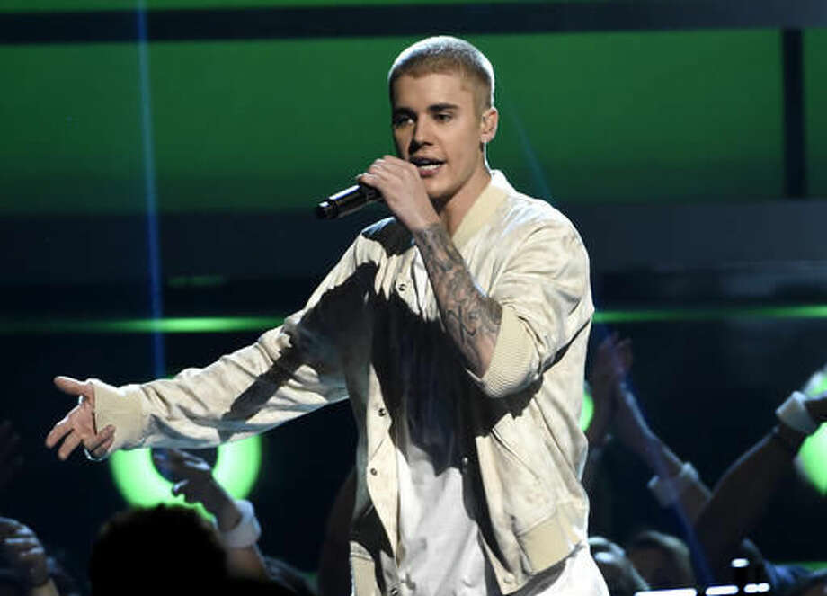 "FILE - In this May 22, 2016 file photo, Justin Bieber performs at the Billboard Music Awards in Las Vegas. Bieber walked off the stage during his show in Manchester, England, Sunday after some fans ignored his request to stop screaming as he was trying to talk to the crowd in between songs. Bieber returned to the stage and told the crowd he'd stop talking and just do his musical set, because he said ""Manchester just can't handle it."" (Photo by Chris Pizzello/Invision/AP, File)"