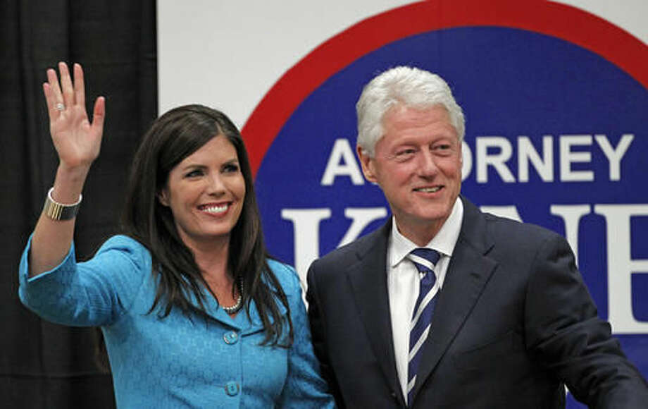 FILE - In this April 12, 2012, file photo, Kathleen Kane, left, a Democratic candidate for Pennsylvania attorney general, waves with former President Bill Clinton after he endorsed her in a speech at Upper Moreland High School in Willow Grove, Pa. Former Pennsylvania Attorney General Kathleen Kane, convicted of leaking grand jury documents to embarrass a rival and then lying about it under oath, is scheduled to be sentenced Monday, Oct. 24, 2016, in Montgomery County, the same county where Clinton campaigned for her in 2012. (AP Photo/Alex Brandon, File)
