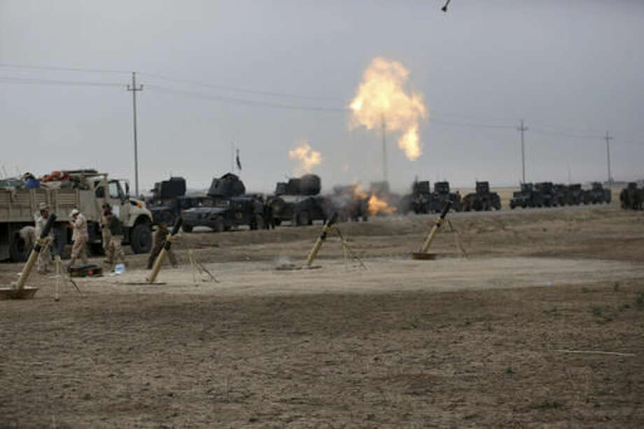 Iraqi special forces bomb Islamic State positions as fighting to retake the extremist-held city of Mosul enters its second week, in the village of Tob Zawa, outside Mosul, Monday, Oct. 24, 2016. A convoy of special forces advanced toward the village of Tob Zawa, Monday, encountering roadside bombs and trading heavy fire with the militants. Loudspeakers on the Humvees blared Iraqi patriotic music as they pushed toward the village. (AP Photo/Khalid Mohammed)