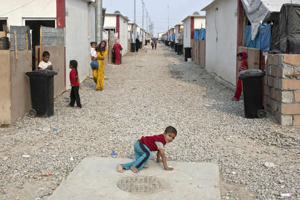 A child plays at a camp for displaced families in Dibaga, near Mosul, Iraq, Monday, Oct. 24, 2016. The campaign to retake Mosul comes after months of planning and involves more than 25,000 Iraqi troops, Kurdish forces, Sunni tribal fighters and state-sanctioned Shiite militias. It is expected to take weeks, if not months, to drive IS out of Iraq's second largest city, which is still home to more than a million people.(AP Photo/Marko Drobnjakovic)