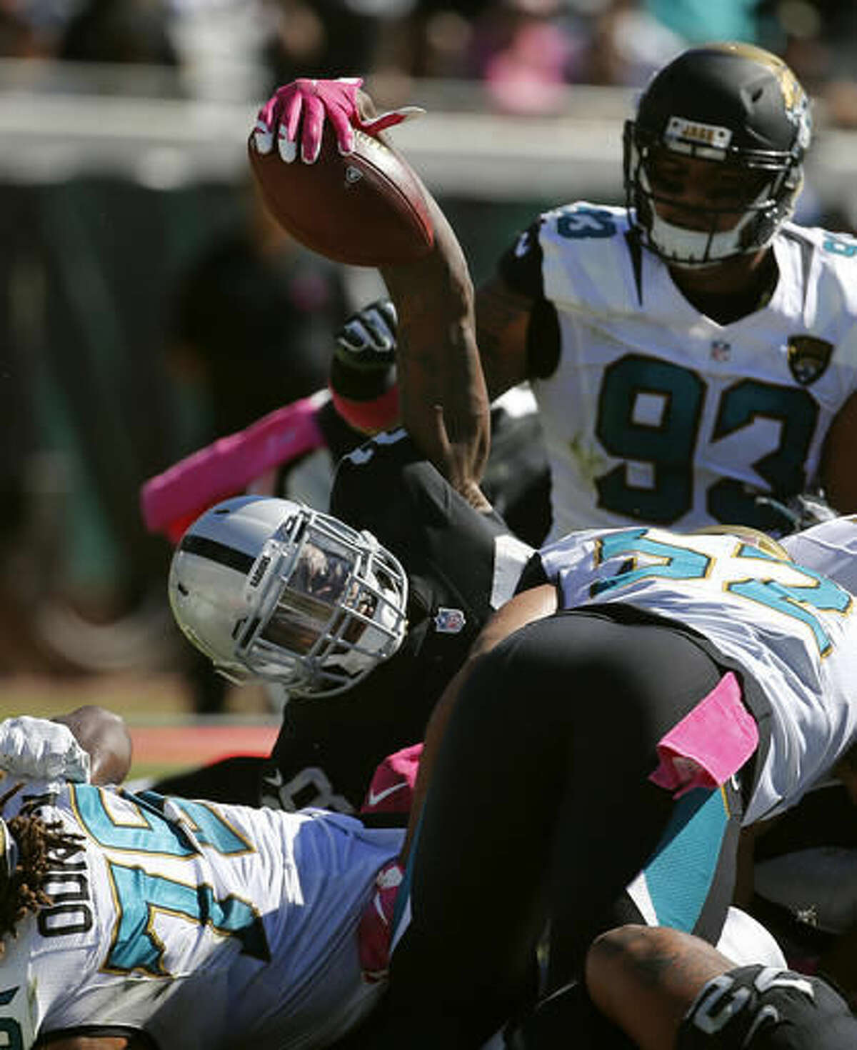 Oakland Raiders running back Latavius Murray (28) lifts the ball over the line for a two-yard touchdown run against the Jacksonville Jaguars during the second quarter of an NFL football game Sunday, Oct. 23, 2016, in Jacksonville, Fla. (AP Photo/Stephen B. Morton)