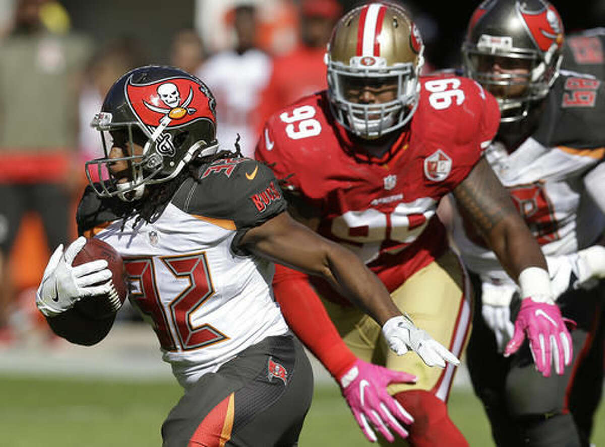 Tampa Bay Buccaneers running back Jacquizz Rodgers (32) runs in front of San Francisco 49ers defensive end DeForest Buckner (99) during the first half of an NFL football game in Santa Clara, Calif., Sunday, Oct. 23, 2016. (AP Photo/Ben Margot)
