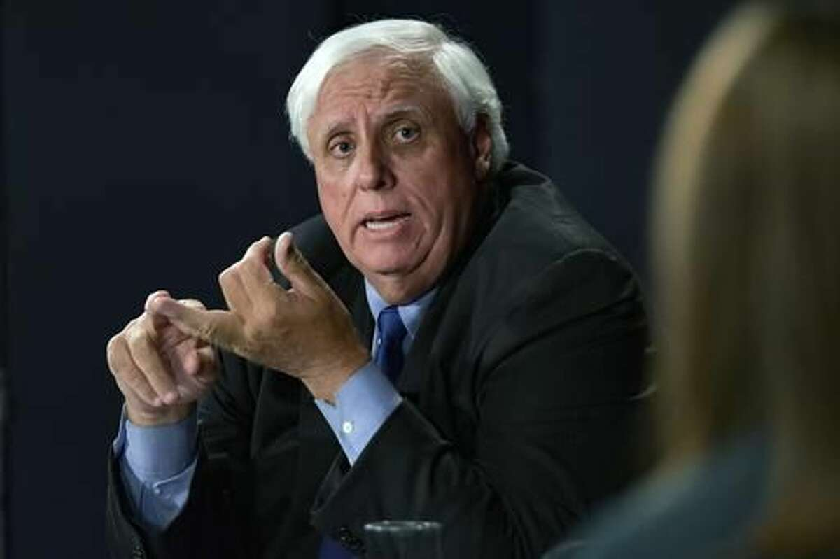 FILE -In this Tuesday, Oct. 4, 2016 file photo, Democratic candidate Jim Justice speaks during a gubernatorial debate against Senate Majority Leader Bill Cole R-W.Va., at the Clay Center in Charleston W.Va. Justice, a coal billionaire running for West Virginia governor, owes millions in back taxes to some of Appalachia's most impoverished counties, according to tax records and government officials. (AP Photo/Tyler Evert)