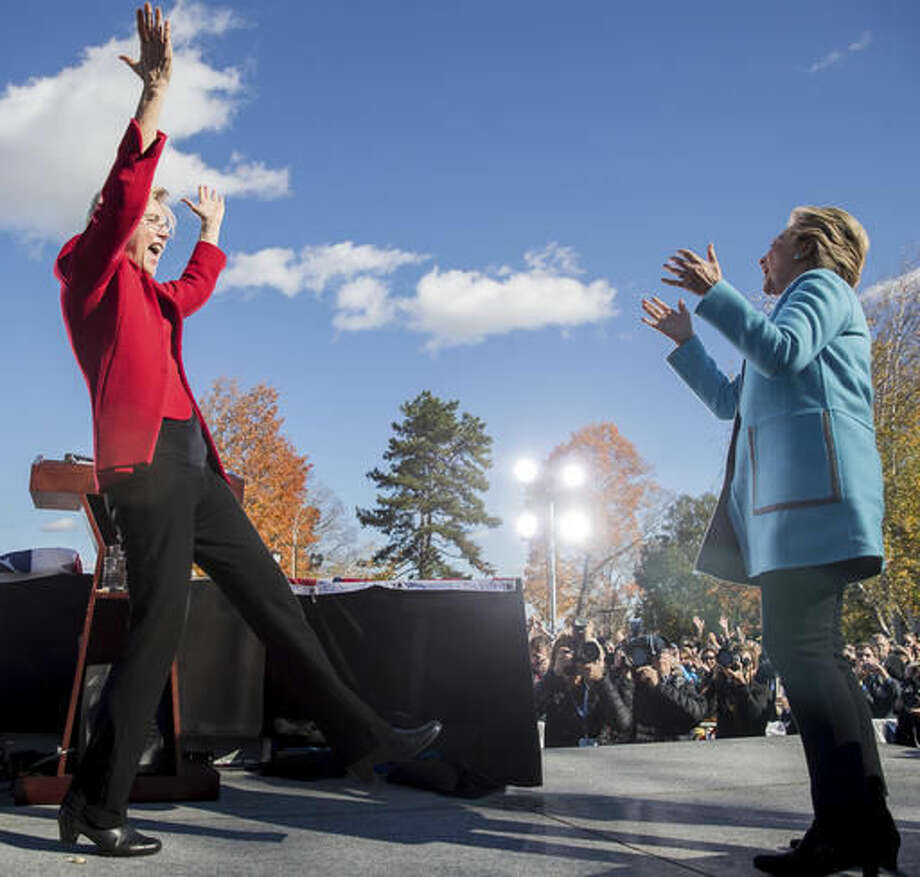 Democratic presidential candidate Hillary Clinton, right, is welcomed to the podium by by Sen. Elizabeth Warren, D-Mass. at a rally at St. Anselm College in Manchester, N.H., Monday, Oct. 24, 2016. (AP Photo/Andrew Harnik)