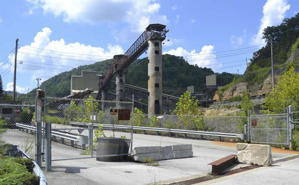 In this Aug. 31, 2016 photo, a coal mine owned by West Virginia gubernatorial candidate Jim Justice sits idle near Hindman, Ky. Justice's coal companies owe millions in taxes to several Kentucky counties amid a decline in coal production. (AP Photo/Dylan Lovan)