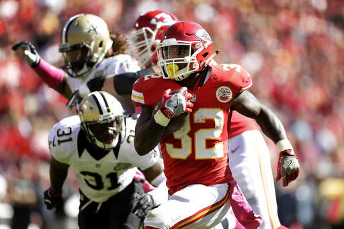 Kansas City Chiefs running back Spencer Ware (32) runs for a touchdown past New Orleans Saints safety Jairus Byrd (31) during the first half of an NFL football game in Kansas City, Mo., Sunday, Oct. 23, 2016. (AP Photo/Colin E. Braley)