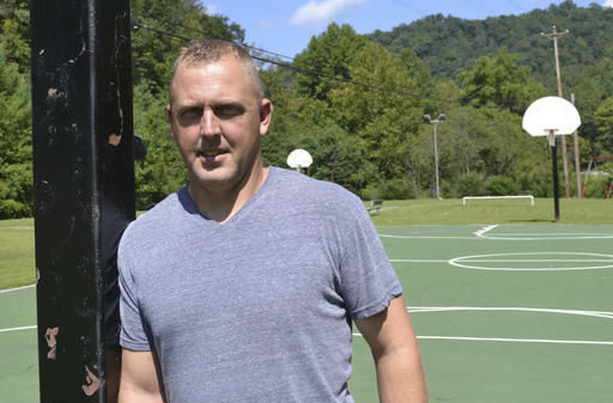 In this Aug. 31, 2016 photo, Knott County's parks director, Chris Amburgey, is pictured at one of the county's parks in Redfox, Ky. Amburgey has taken on several other jobs as the county struggles to pay its bills amid a decline in the coal industry. A company owned by West Virginia gubernatorial candidate Jim Justice owes more than $2 million in taxes to the county. (AP Photo/Dylan Lovan)