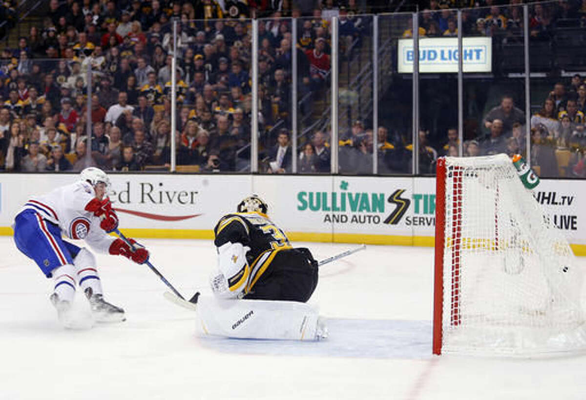 Montreal Canadiens' Paul Byron scores a shorthanded goal on Boston Bruins goalie Anton Khudobin during the third period of the Montreal Canadiens 4-2 win over the Boston Bruins in an NHL hockey game in Boston on Saturday, Oct. 22, 2016. (AP Photo/Winslow Townson)
