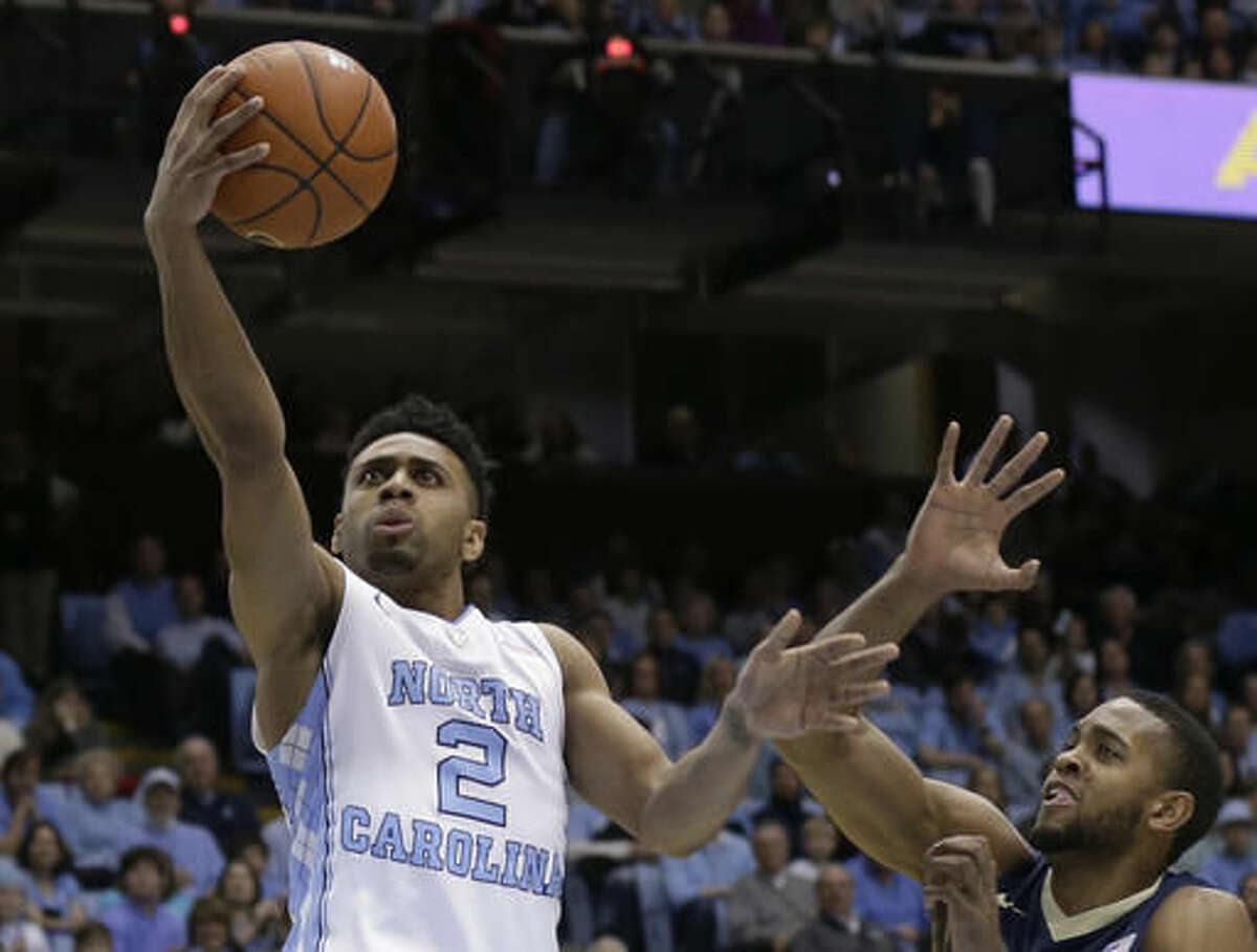 In this Feb. 14, 2016, photo, North Carolina's Joel Berry II (2) drives to the basket against Pittsburgh's Sheldon Jeter (21) during the first half of an NCAA college basketball game in Chapel Hill, N.C. Berry is the top returning scorer for a team that won the ACC regular-season and tournament titles before losing to Villanova in the NCAA championship game. (AP Photo/Gerry Broome)