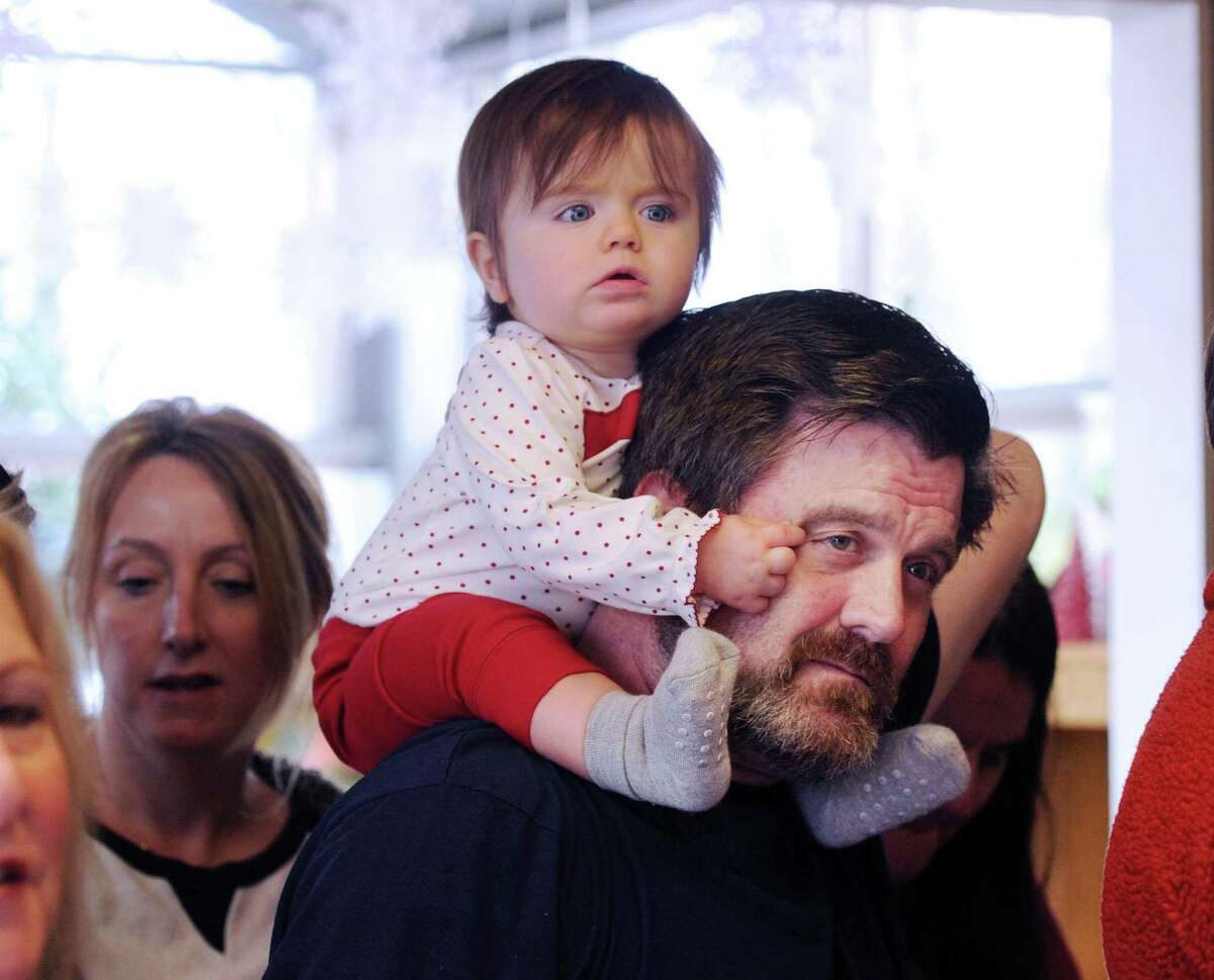Molly Flanagan, 11-months-old of Fairfield, rides high on the shoulders of her dad, Rich Flanagan, to get a peek at Santa during the 8th annual Greenwich Reindeer Festival & Santa's Village event in Greenwich Nov. 25.