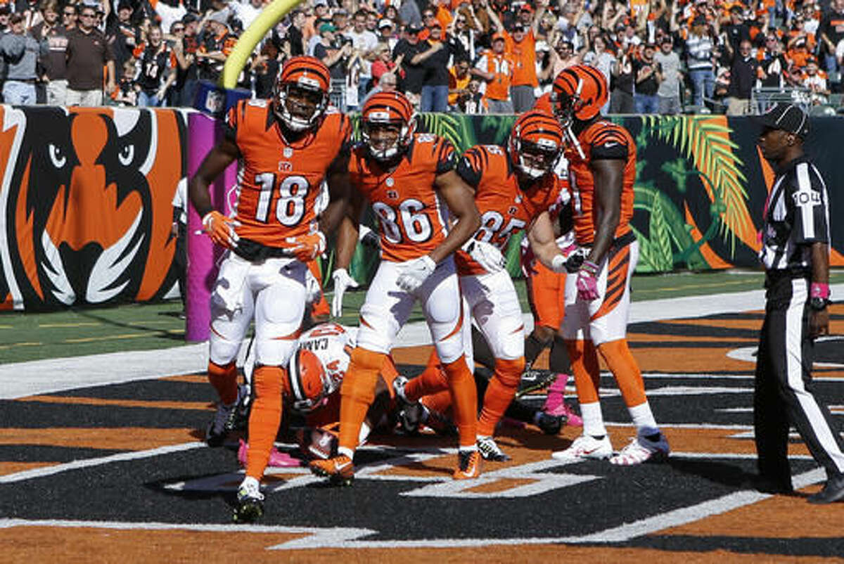 Cincinnati Bengals wide receiver A.J. Green (18) celebrates with teammates after catching a touchdown in the end zone in the first half of an NFL football game against the Cleveland Browns, Sunday, Oct. 23, 2016, in Cincinnati. (AP Photo/Frank Victores)