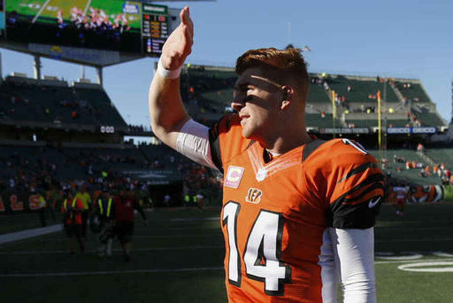 Cincinnati Bengals quarterback Andy Dalton walks off the field after an NFL football game against the Cleveland Browns, Sunday, Oct. 23, 2016, in Cincinnati. (AP Photo/Gary Landers)