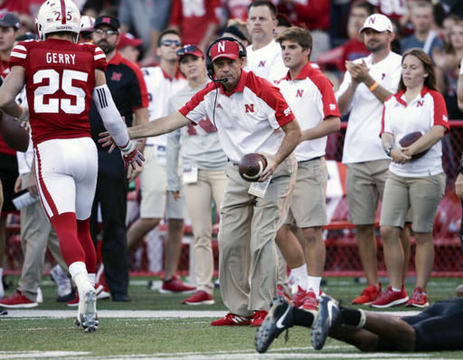 Nebraska head coach Mike Riley, center, congratulates safety Nate Gerry (25) who tackled Purdue wide receiver Anthony Mahoungou, bottom right, during the second half of an NCAA college football game in Lincoln, Neb., Saturday, Oct. 22, 2016. (AP Photo/Nati Harnik)