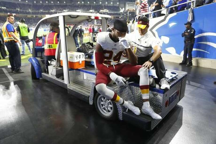 Washington Redskins cornerback Josh Norman is carted off the field during the second half of an NFL football game against the Detroit Lions, Sunday, Oct. 23, 2016 in Detroit. (AP Photo/Paul Sancya)