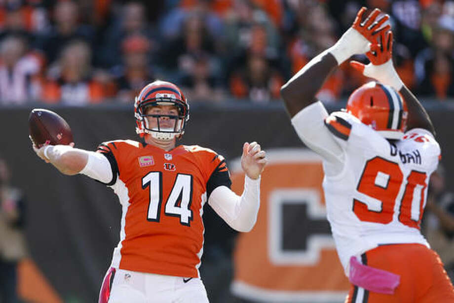 Cincinnati Bengals quarterback Andy Dalton (14) throws past Cleveland Browns outside linebacker Emmanuel Ogbah (90) in the second half of an NFL football game, Sunday, Oct. 23, 2016, in Cincinnati. (AP Photo/Gary Landers)