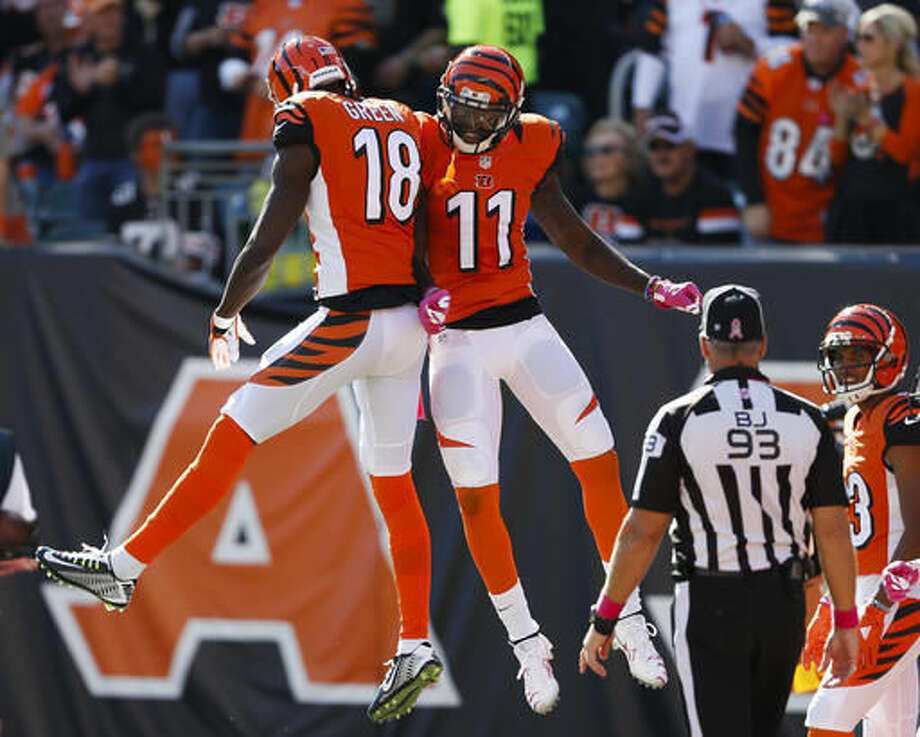 Cincinnati Bengals wide receiver Brandon LaFell (11) celebrates his touchdown with wide receiver A.J. Green (18) in the first half of an NFL football game against the Cleveland Browns, Sunday, Oct. 23, 2016, in Cincinnati. (AP Photo/Gary Landers)