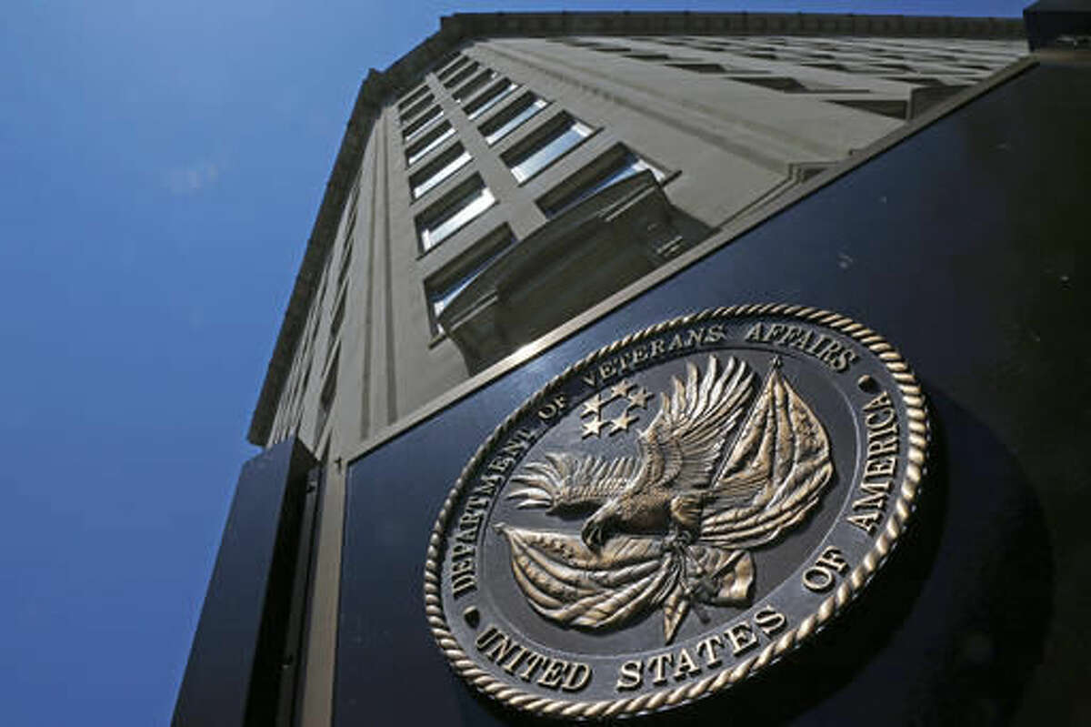 FILE - In this June 21, 2013, file photo, the seal a fixed to the front of the Department of Veterans Affairs building in Washington. There are an estimated 21.6 million veterans in the United States. Among them, nearly 9 million are enrolled in health care provided by the VA. About 4.3 million veterans get disability compensation from the VA and nearly 900,000 have been diagnosed with post-traumatic stress disorder. A 2014 law signed by President Barack Obama aimed to alleviate delays many veterans faced in getting treatment at VA hospitals and clinics and end the widespread practice of fake wait lists that covered up long waits for veterans seeking health care. Two years later, many of the problems remain.(AP Photo/Charles Dharapak, File)