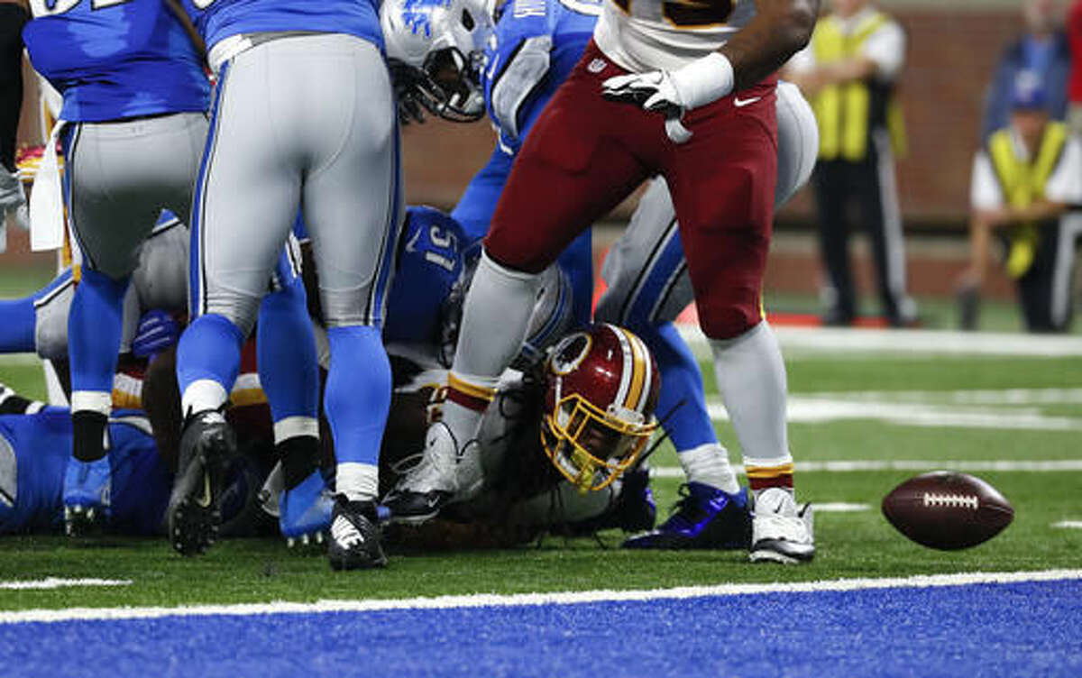 In this photo taken Oct. 24, 2016, Washington Redskins running back Matt Jones fumbles into the end zone against the Detroit Lions during an NFL football game in Detroit. Detroit recovered the fumble. Jones' problems holding onto the football are hardly the only mistake the Washington Redskins will want to correct before they play again. Still, Jones' fumbling woes are going to get a lot of attention until Washington (4-3) lines up against the Cincinnati Bengals (3-4) in London next Sunday, Oct.30, 2016. (AP Photo/Paul Sancya)