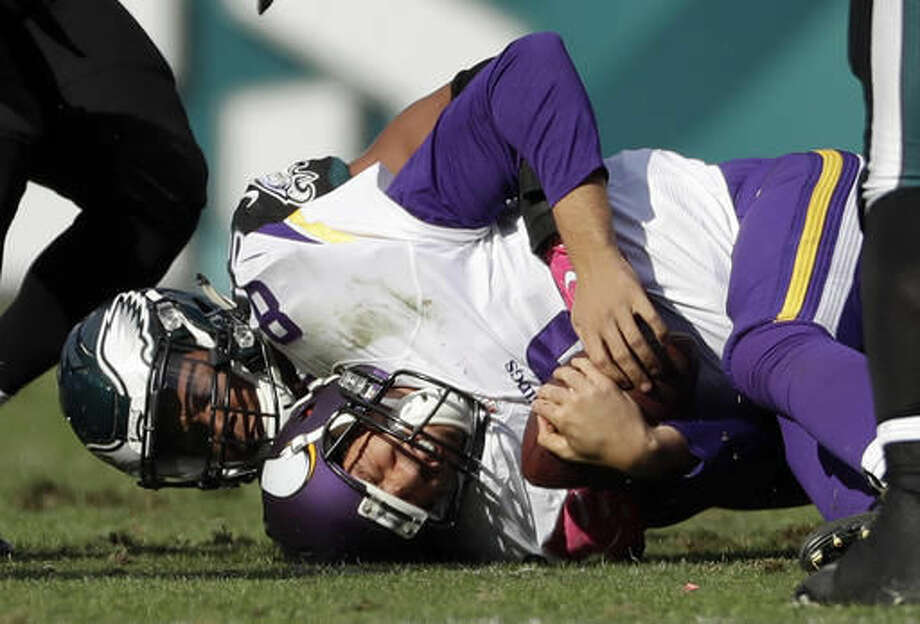 Minnesota Vikings' Sam Bradford (8) is tackled by Philadelphia Eagles' Jordan Hicks during the second half of an NFL football game, Sunday, Oct. 23, 2016, in Philadelphia. (AP Photo/Michael Perez)