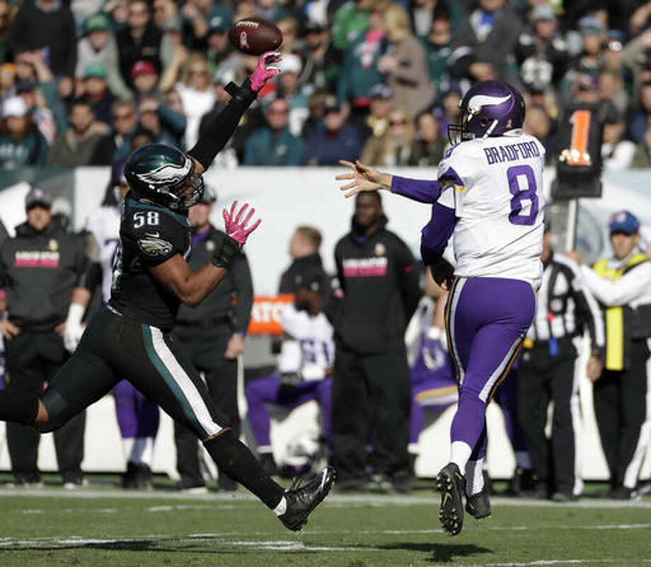 Minnesota Vikings' Sam Bradford, right, tries to pass against Philadelphia Eagles' Jordan Hicks during the second half of an NFL football game, Sunday, Oct. 23, 2016, in Philadelphia. (AP Photo/Michael Perez)