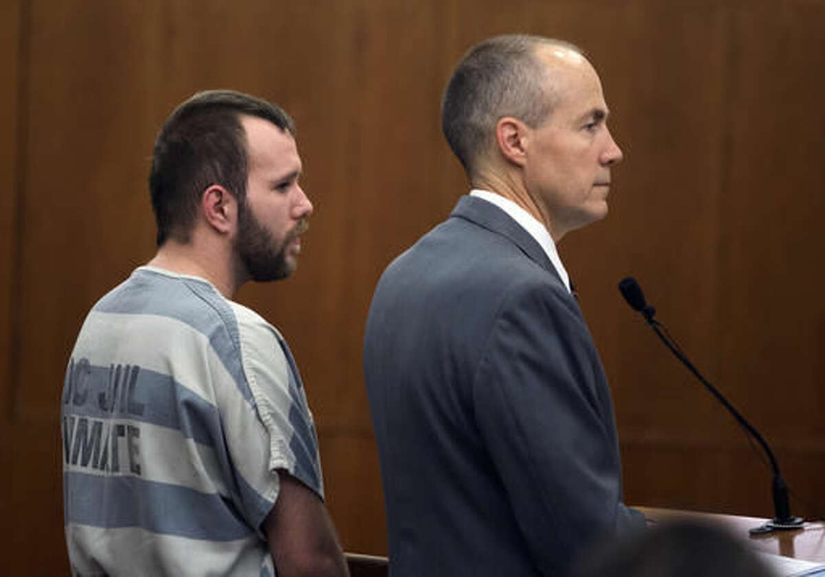 Dereck James Harrison, left, stands beside his attorney Michael Edwards in a courtroom on Monday, Oct. 24, 2016, in Farmington, Utah. Harrison, who pleaded guilty to tying up five people in a basement was sentenced to serve at least 30 years up to life in prison, but first he'll face murder charges in Wyoming connected to the same crime spree. Harrison is expected to be extradited shortly after his sentencing Monday in Utah. (Briana Scroggins/Utah Standard-Examiner via AP, Pool)