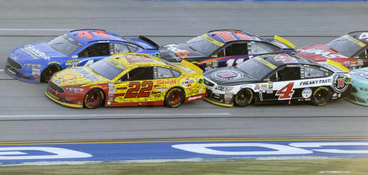 Joey Logano (22) leads off during a restart after a caution flag during the NASCAR Sprint Cup Series auto race auto race at Talladega Superspeedway, Sunday, Oct. 23, 2016, in Talladega, Ala. (AP Photo/Rainier Ehrhardt)