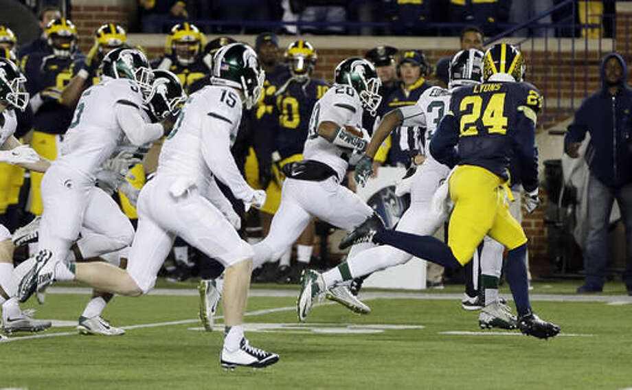 FILE - In this Oct. 17, 2015, file photo, Michigan State defensive back Jalen Watts-Jackson (20) runs towards the end zone after recovering a fumble on a punt in the closing seconds of the second half of an NCAA college football game against Michigan, in Ann Arbor, Mich. Michigan State defeated Michigan 27-23. (AP Photo/Carlos Osorio)