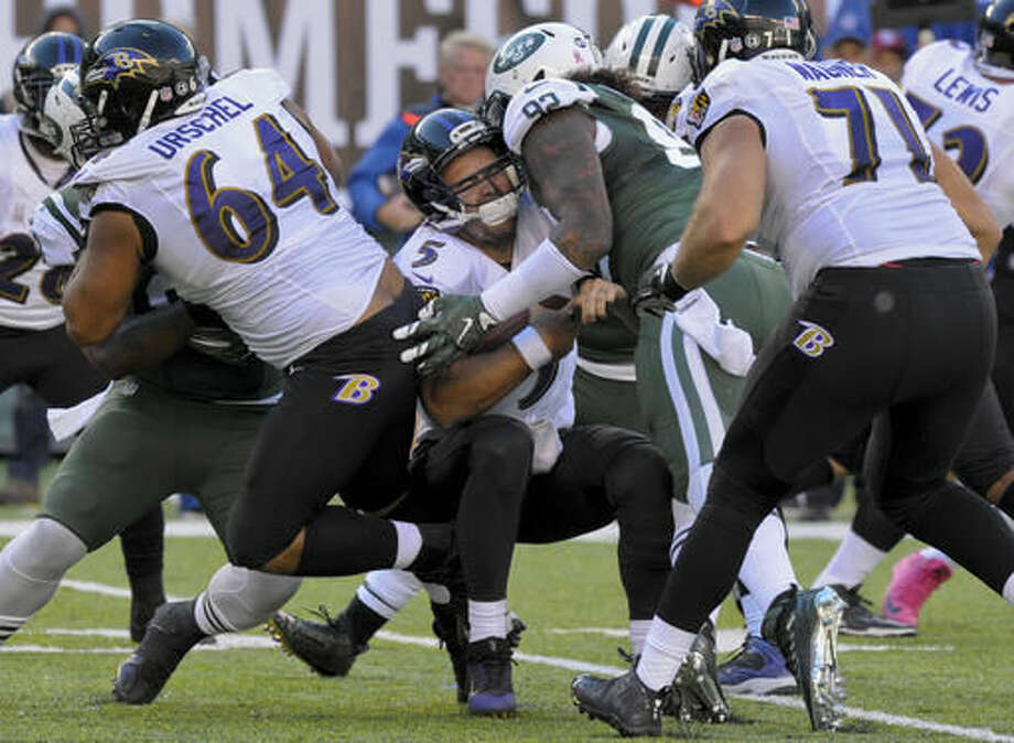 Baltimore Ravens quarterback Joe Flacco (5) is sacked by New York Jets defensive tackle Leonard Williams (92) during the fourth quarter of an NFL football game, Sunday, Oct. 23, 2016, in East Rutherford, N.J. (AP Photo/Bill Kostroun)