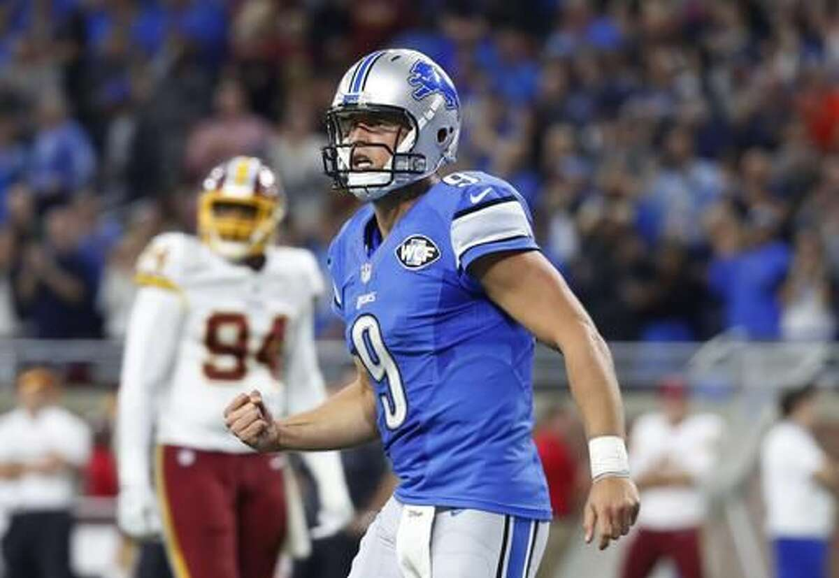 Detroit Lions quarterback Matthew Stafford clenches his fist after a touchdown pass to wide receiver Anquan Boldin during the second half of an NFL football game against the Washington Redskins, Sunday, Oct. 23, 2016 in Detroit. (AP Photo/Paul Sancya)