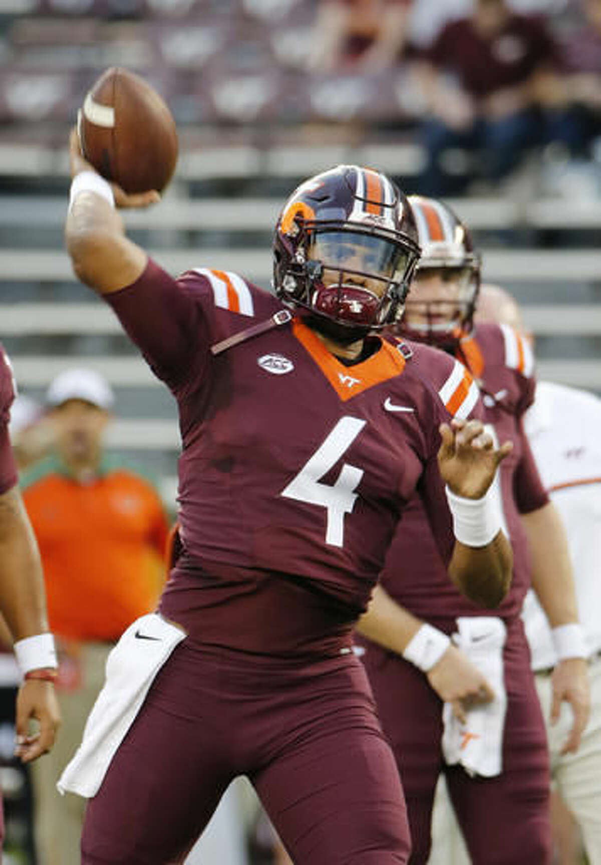 FILE - In this Oct. 20, 2016, file photo, Virginia Tech quarterback Jerod Evans (4) tosses a pass prior to the start of the Miami-Virginia Tech NCAA college football game at Lane stadium in Blacksburg, Va. Virginia Tech has its destiny in its hands if it wants to represent the ACC's Coastal Division in the league title game. (AP Photo/Steve Helber, File)