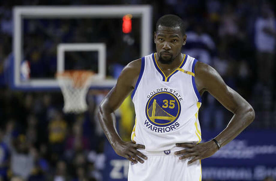 Golden State Warriors' Kevin Durant waits during a timeout in the second half of the team's preseason NBA basketball game against the Portland Trail Blazers on Friday, Oct. 21, 2016, in Oakland, Calif. (AP Photo/Ben Margot)