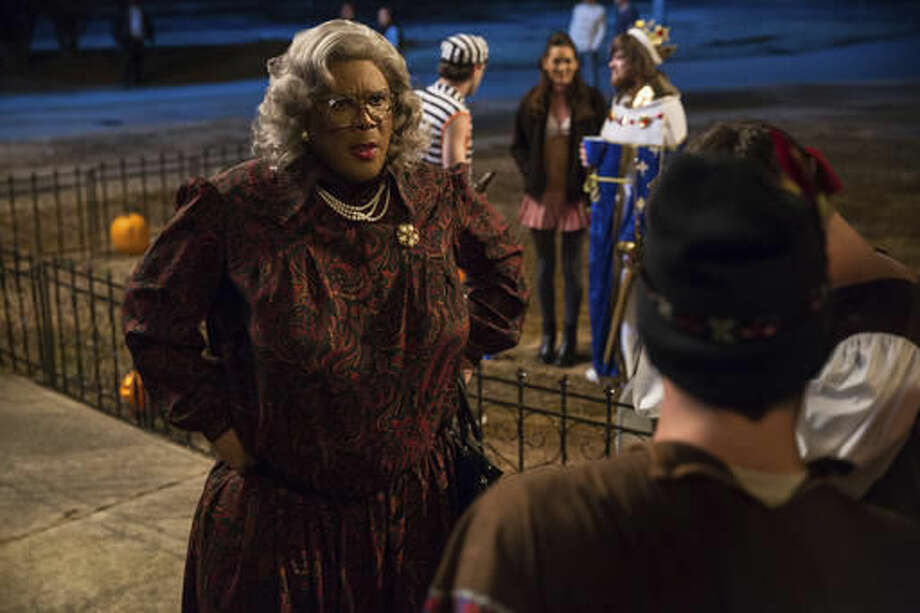 "In this image released by Lionsgate, Tyler Perry portrays Madea in a scene from, ""Tyler Perry's Boo! A Madea Halloween."" (Daniel McFadden/Lionsgate via AP)"
