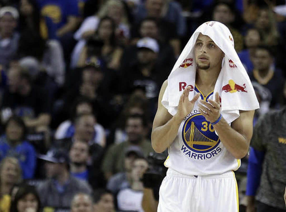 Golden State Warriors' Stephen Curry applauds during a timeout in the second half of the team's preseason NBA basketball game against the Portland Trail Blazers on Friday, Oct. 21, 2016, in Oakland, Calif. (AP Photo/Ben Margot)