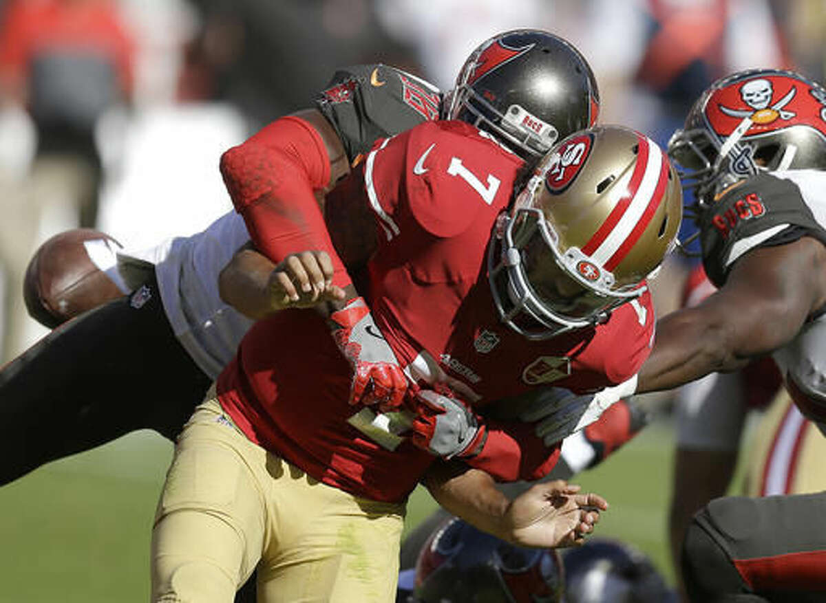 San Francisco 49ers quarterback Colin Kaepernick (7) fumbles the ball as he is hit by Tampa Bay Buccaneers cornerback Jude Adjei-Barimah during the second half of an NFL football game in Santa Clara, Calif., Sunday, Oct. 23, 2016. The Buccaneers recovered the fumble. (AP Photo/Ben Margot)
