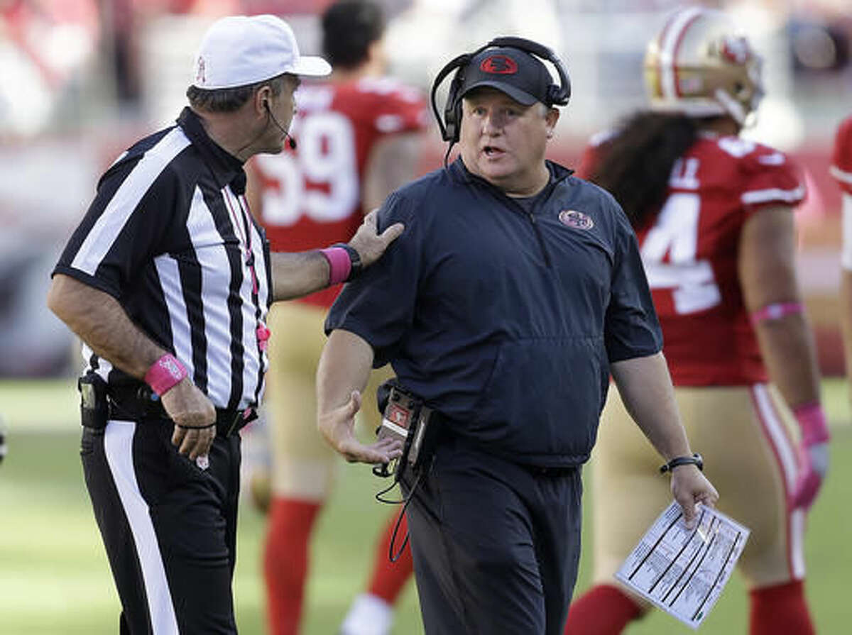 San Francisco 49ers head coach Chip Kelly talks with referee Pete Morelli during the second half of an NFL football game between the 49ers and the Tampa Bay Buccaneers in Santa Clara, Calif., Sunday, Oct. 23, 2016. (AP Photo/Ben Margot)