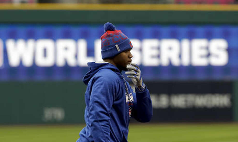 Chicago Cubs left fielder Jorge Soler warms up during a team practice for baseball's upcoming World Series against the Chicago Cubs on Monday, Oct. 24, 2016 in Cleveland. (AP Photo/David J. Phillip)