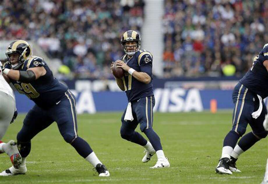 Los Angeles Rams quarterback Case Keenum (17) prepares to throw the ball during an NFL football game between New York Giants and Los Angeles Rams at Twickenham stadium in London, Sunday Oct. 23, 2016. (AP Photo/Matt Dunham)