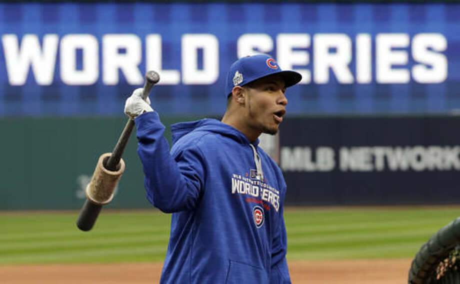 Chicago Cubs catcher Willson Contreras warms up during a team practice for baseball's upcoming World Series against the Chicago Cubs on Monday, Oct. 24, 2016 in Cleveland. (AP Photo/David J. Phillip)