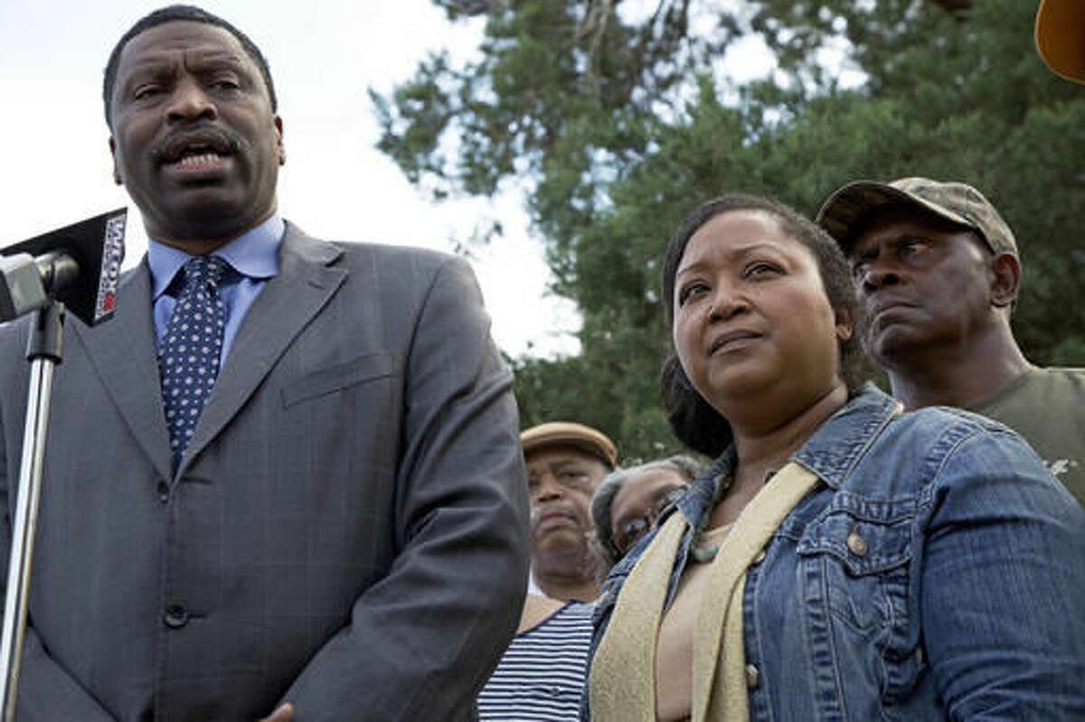 CORRECTS STATE TO MISSISSIPPI - Derrick Johnson, left, president of the Mississippi NAACP, talks to the media on behalf of Stacey Payton, center right, and Hollis Payton, right, the parents of a high school student, in front of the Stone County Courthouse in Wiggins, Miss., Monday, Oct. 24, 2016. Johnson is demanding a federal investigation after the parents said four white students put a noose around their son's neck at school. (AP Photo/Max Becherer)