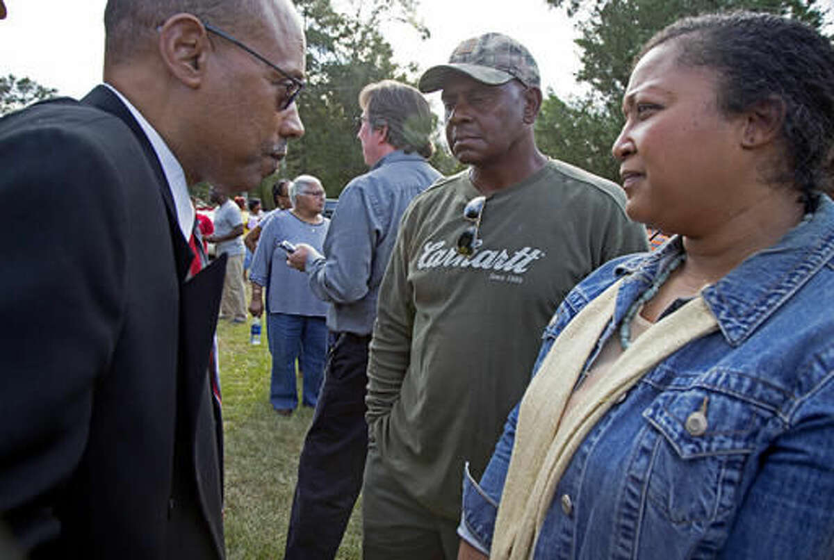 President of the Stone County branch of the Mississippi State Conference of the NAACP, Reverend Robert James, left, talks with Stacey Payton, right, and Hollis Payton, center, the parents of a high school student, in front of the Stone County Courthouse in Wiggins, Miss., Monday, Oct. 24, 2016. Johnson is demanding a federal investigation after the parents said four white students put a noose around their son's neck at school. (AP Photo/Max Becherer)