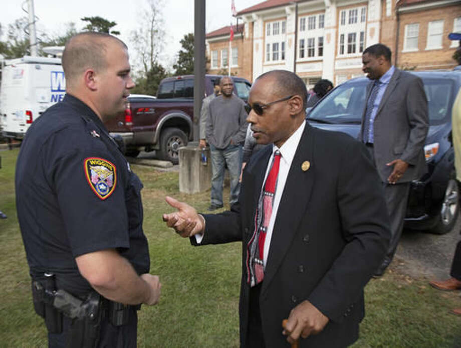 President of the Stone County branch of the Mississippi State Conference of the NAACP, Rev. Robert James, right, talks with Wiggins City Police Officer, Cpl. Thomas Reynolds in front of the Stone County Courthouse in Wiggins, Miss., Monday, Oct. 24, 2016. Derrick Johnson, the president of the Mississippi NAACP, is demanding a federal investigation after the parents of a black high school student said four white students put a noose around their son's neck at school. (AP Photo/Max Becherer)