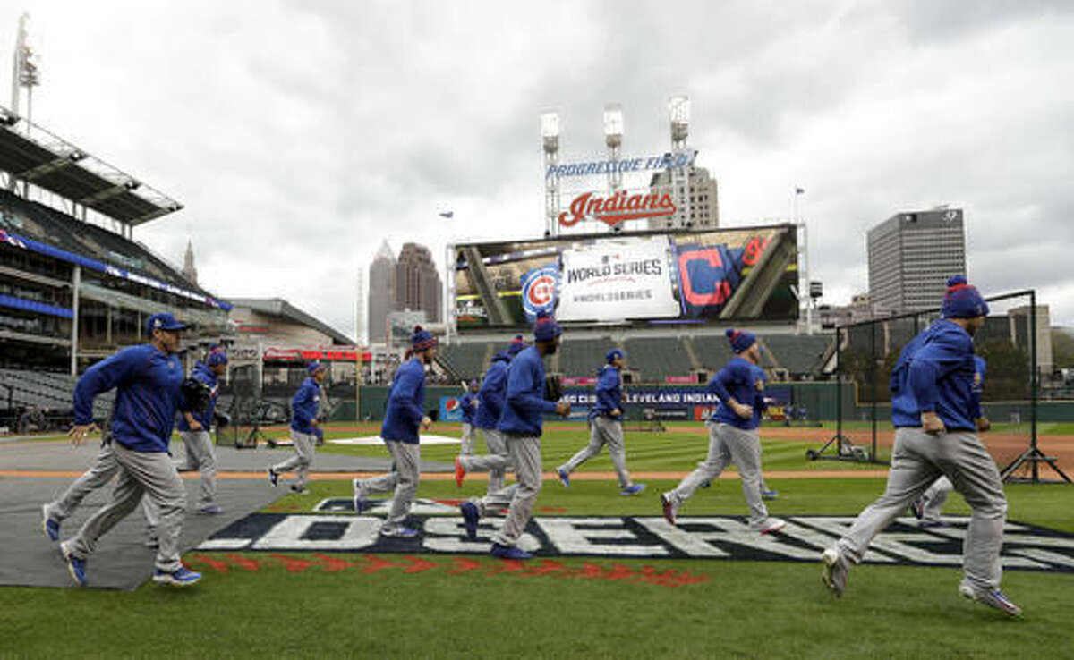 Members of the Chicago Cubs warm up during a team practice for baseball's upcoming World Series against the Cleveland Indians on Monday, Oct. 24, 2016 in Cleveland. (AP Photo/David J. Phillip)