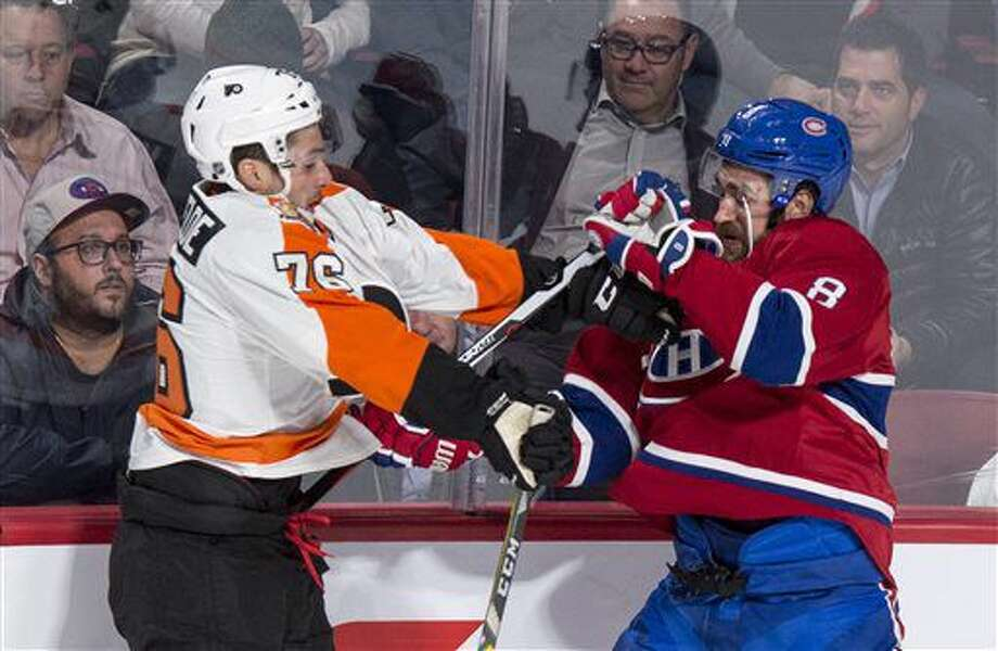 Montreal Canadiens' Greg Pateryn (8) fends off Philadelphia Flyers' Chris VandeVelde during first period NHL hockey action in Montreal on Monday, Oct. 24, 2016. (Paul Chiasson/The Canadian Press via AP)