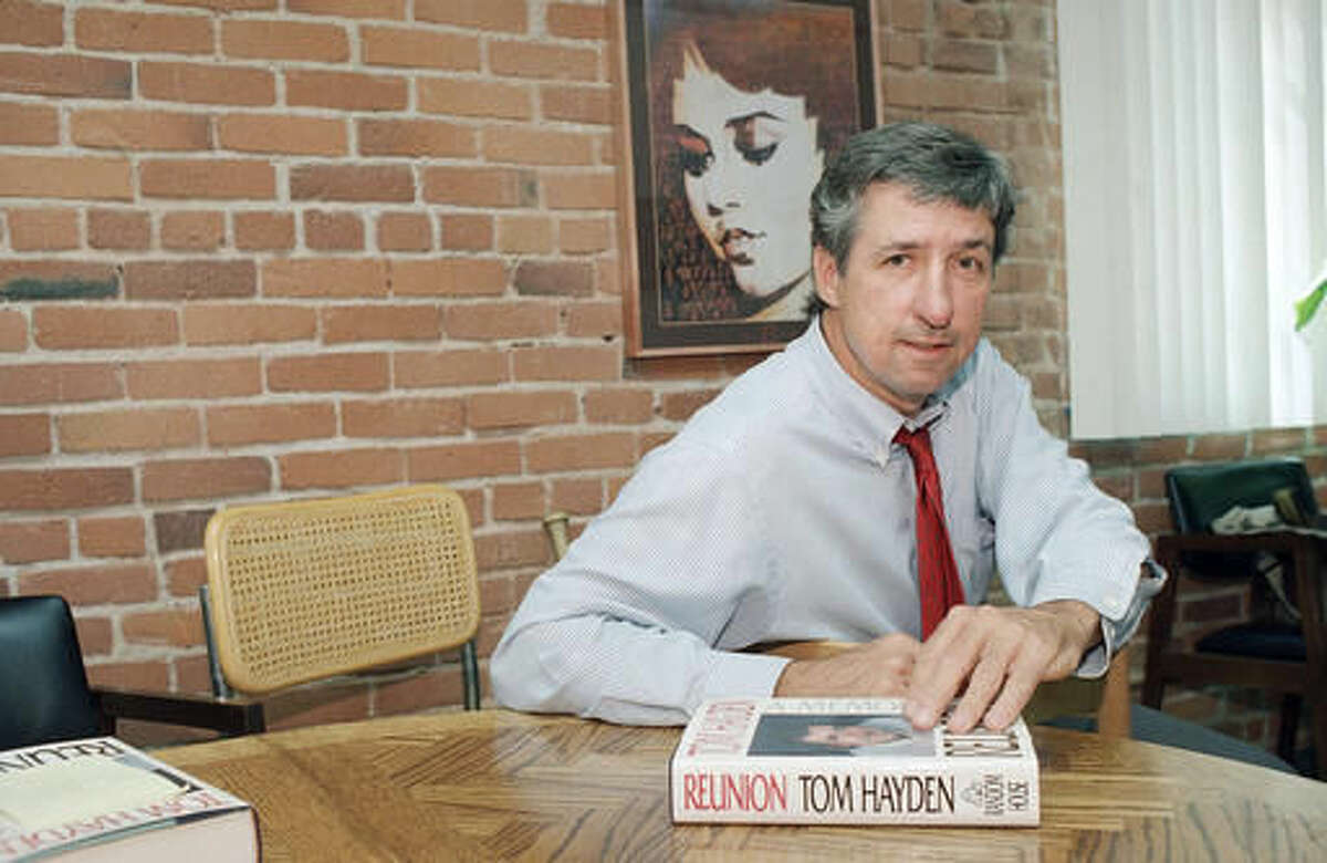 FILE - In this June 6, 1988 file photo, Tom Hayden talks about his new book,