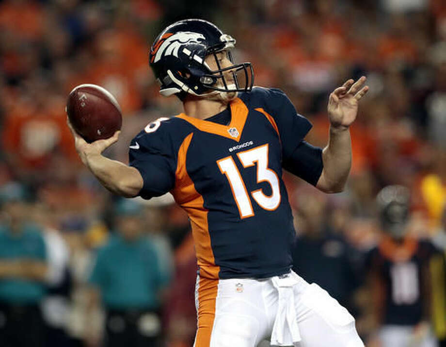 Denver Broncos quarterback Trevor Siemian (13) throws against the Houston Texans during the first half of an NFL football game, Monday, Oct. 24, 2016, in Denver. (AP Photo/Joe Mahoney)