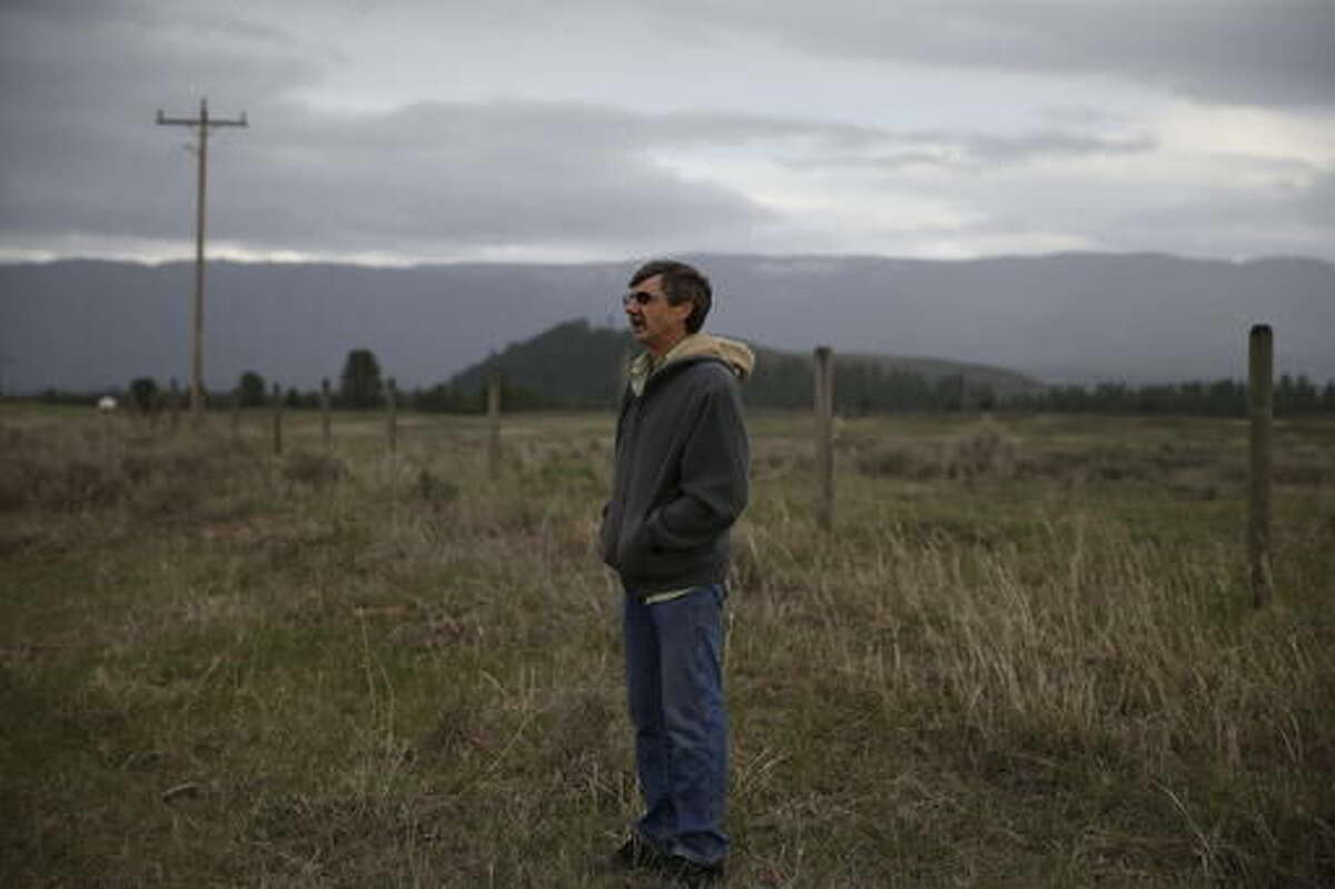 """Jim Buterbaugh, a vocal opponent of refugees coming to his state, stands on ranch land belonging to a friend near Clearwater, Mont., on April 12, 2016. """"It doesn't make any difference if they're Muslims, Russians, whatever. You have to know who they are, what they've been doing in the past,"""" says Buterbaugh, a construction worker who organized three opposition rallies, including one at the state capitol. """"Are you going to go downtown and take five people off the streets and move them into your house without knowing who they are? Nobody in their right mind would do that."""" (AP Photo/Brennan Linsley)"""