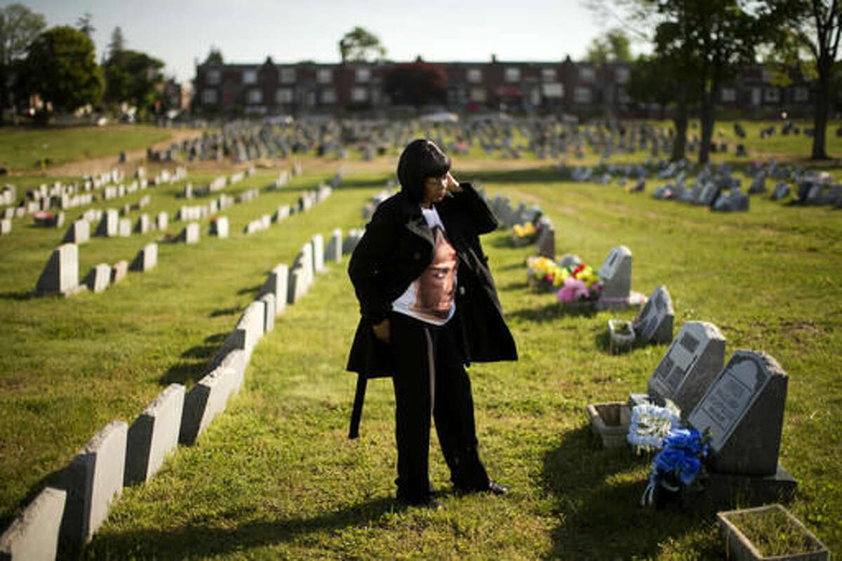 Dorothy Johnson-Speight visits the grave of her son, Khaaliq Jabbar Johnson, in Philadelphia on Monday, May 9, 2016. Johnson was killed in 2001 - shot seven times over a parking space dispute.