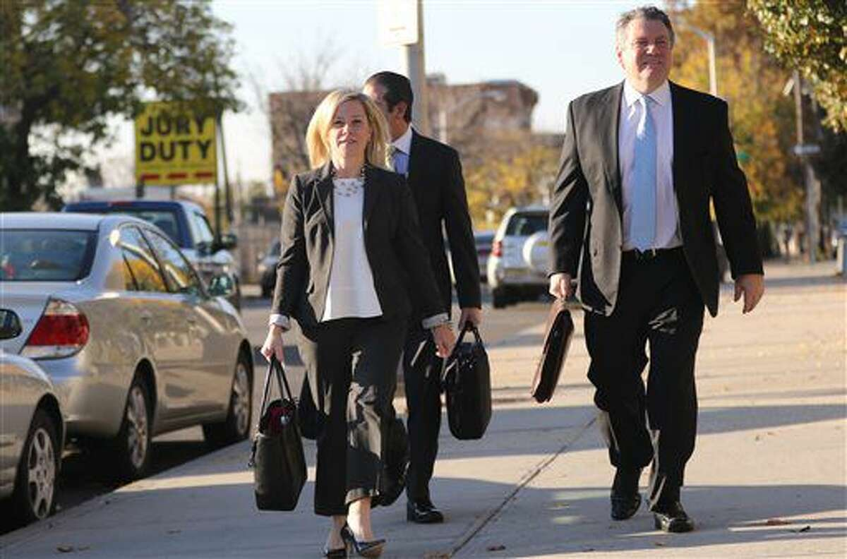 Bridget Anne Kelly and her attorney Michael Critchley Jr. walk towards the Martin Luther King Jr. Federal Court in Newark Monday, Oct. 24, 2016. Kelly testified Monday that she told the governor that the Democratic mayor prosecutors say was targeted by the George Washington Bridge lane closures had complained about retribution while they were going on. (Kevin R. Wexler/The Record-Northjersey.com via AP)