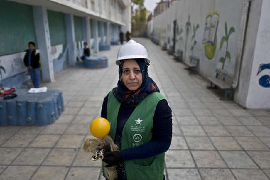 In this Monday, March 21, 2016 photo, Jordanian plumber Maryam Mutlaq, 41, poses for a picture at a school in Zarqa, northeast of Amman. Mutlaq's choice of career is rare for the Arab world where traditional gender roles make men the main breadwinners and confine most women to certain jobs _ teachers, nurses, low-level government clerks. Five years ago, the Arab Spring brought the hope of more opportunities for women. Yet that promise has not panned out, analysts and activists say, and in some cases spreading violence has even led to a backlash. (AP Photo/Muhammed Muheisen)