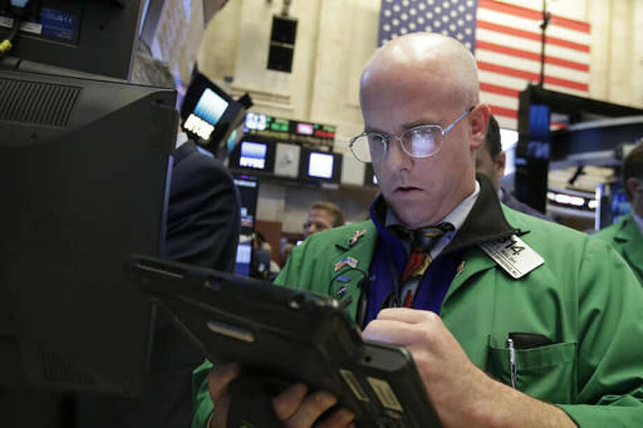 Trader Kevin Walsh works on the floor of the New York Stock Exchange, Monday, Oct. 24, 2016. Stocks are opening higher on Wall Street as traders looked over a big batch of corporate deals. (AP Photo/Richard Drew)